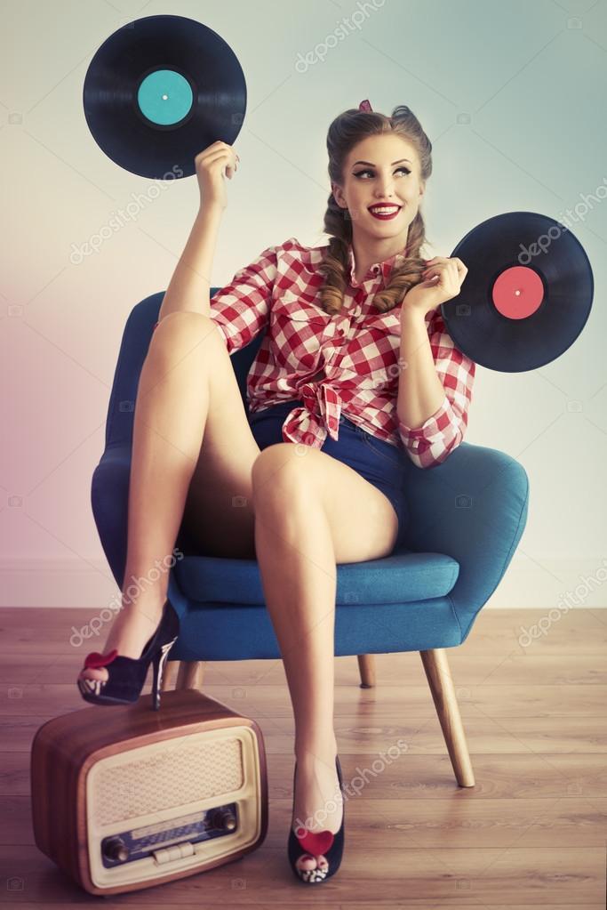 depositphotos_110299112-stock-photo-pin-up-girl-with-vinyl.jpg